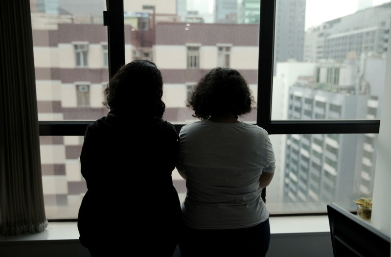 FILE PHOTO: Sisters from Saudi Arabia, who go by aliases Reem and Rawan, are pictured at an office in Hong Kong