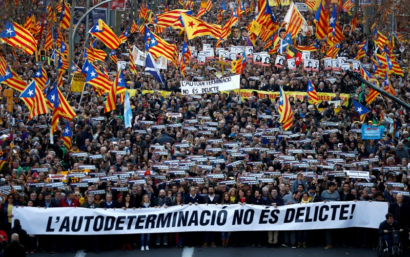 People take part during a rally of Catalan separatist organizations to demonstrate in Barcelona against the trial of Catalan leaders and call for self-determination rights in Barcelona