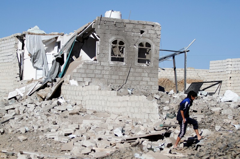 A boy is seen at the site of an airstrike launched by the Saudi-led coalition in Sanaa