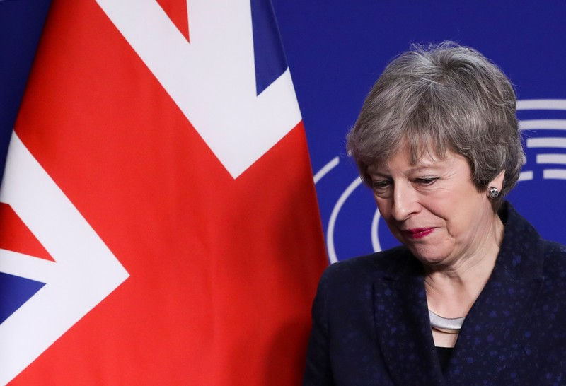 British PM May looks on at EU parliament in Brussels