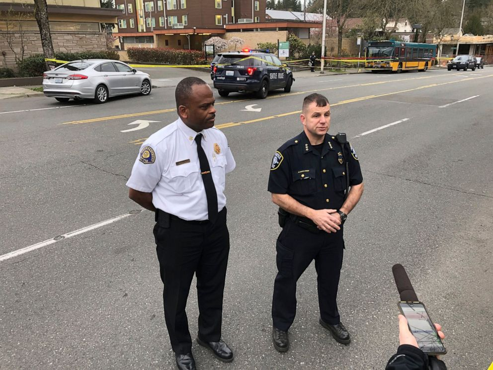 Seattle Fire Chief Harold Scoggins, left, and Deputy Police Chief Marc Garth Green give a media briefing following a shooting in Seattle on Wednesday, March 27, 2019.