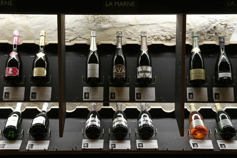 Bottles of Champagne are displayed at Dilettantes wine shop in Paris