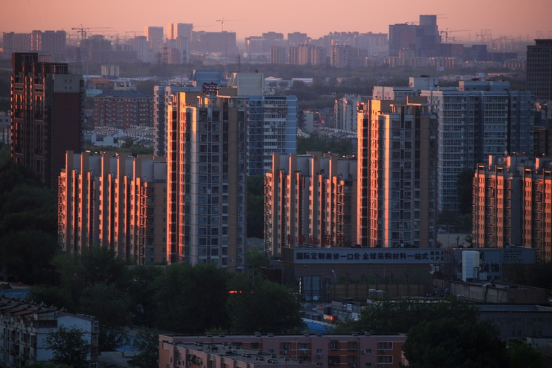 FILE PHOTO: Property buildings are seen against the dawn sky in Beijing