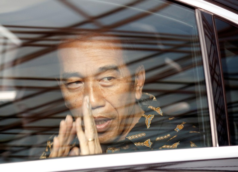 Indonesian President Joko Widodo leaves after visiting former first lady Ani Yudhoyono at a hospital in Singapore