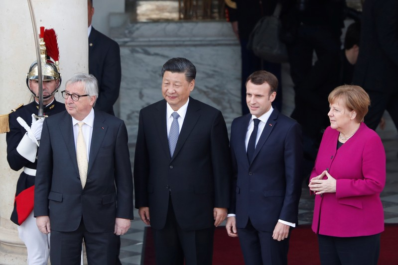 French President Emmanuel Macron poses with German Chancellor Angela Merkel, European Commission President Jean-Claude Juncker and Chinese President Xi Jinping prior to their meeting at the Elysee presidential palace in Paris