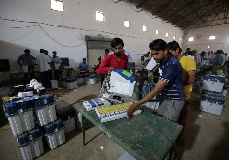FILE PHOTO: Election staff check Voter Verifiable Paper Audit Trail machines and Electronic Voting Machines ahead of India's general election at a warehouse in Ahmedabad