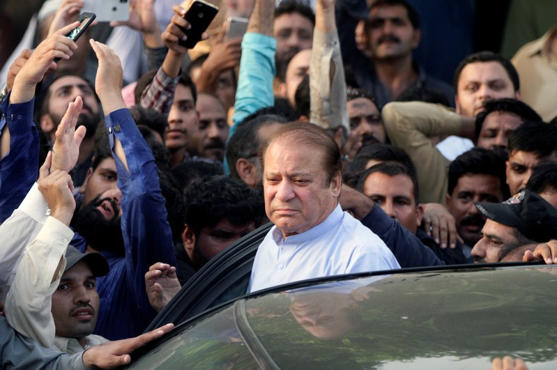 FILE PHOTO: Former Prime Minister Nawaz Sharif arrives to attend funeral services for his wife, Kulsoom, in Lahore
