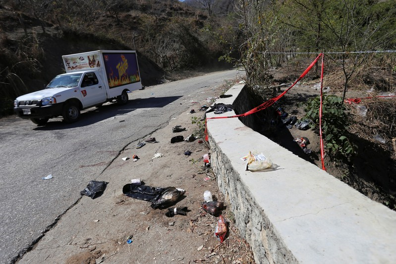 A view shows clothing and items scattered on the site where a cargo truck careened off a road and turned over, killing at least 25 migrants from Central America, in Francisco Sarabia