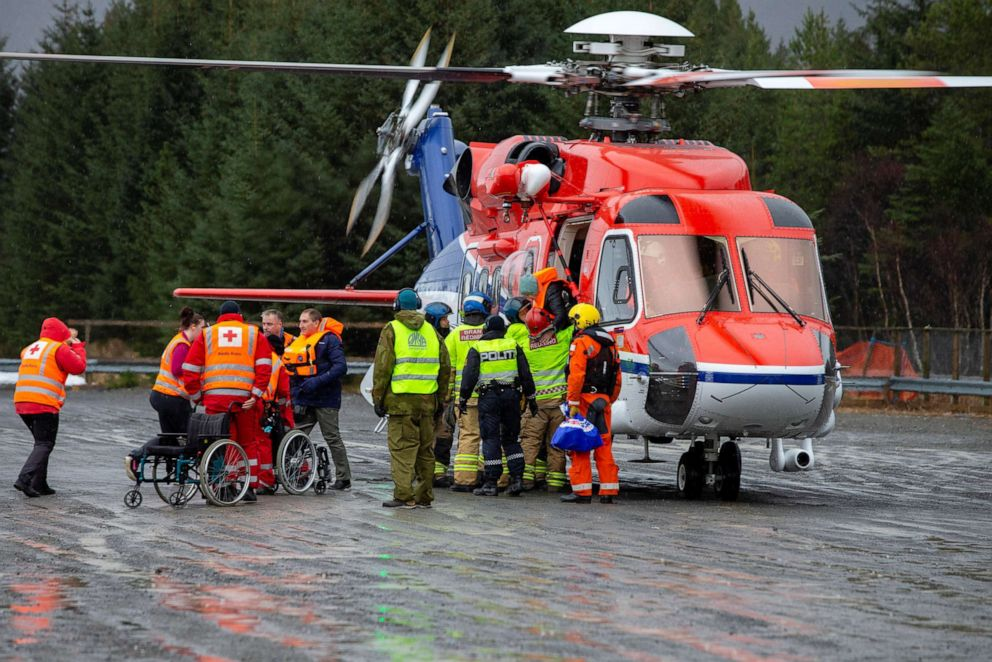 Passengers are helped out of a rescue helicopter after being rescued from cruise ship Viking Sky in Hustadvika, Norway, March 24, 2019.