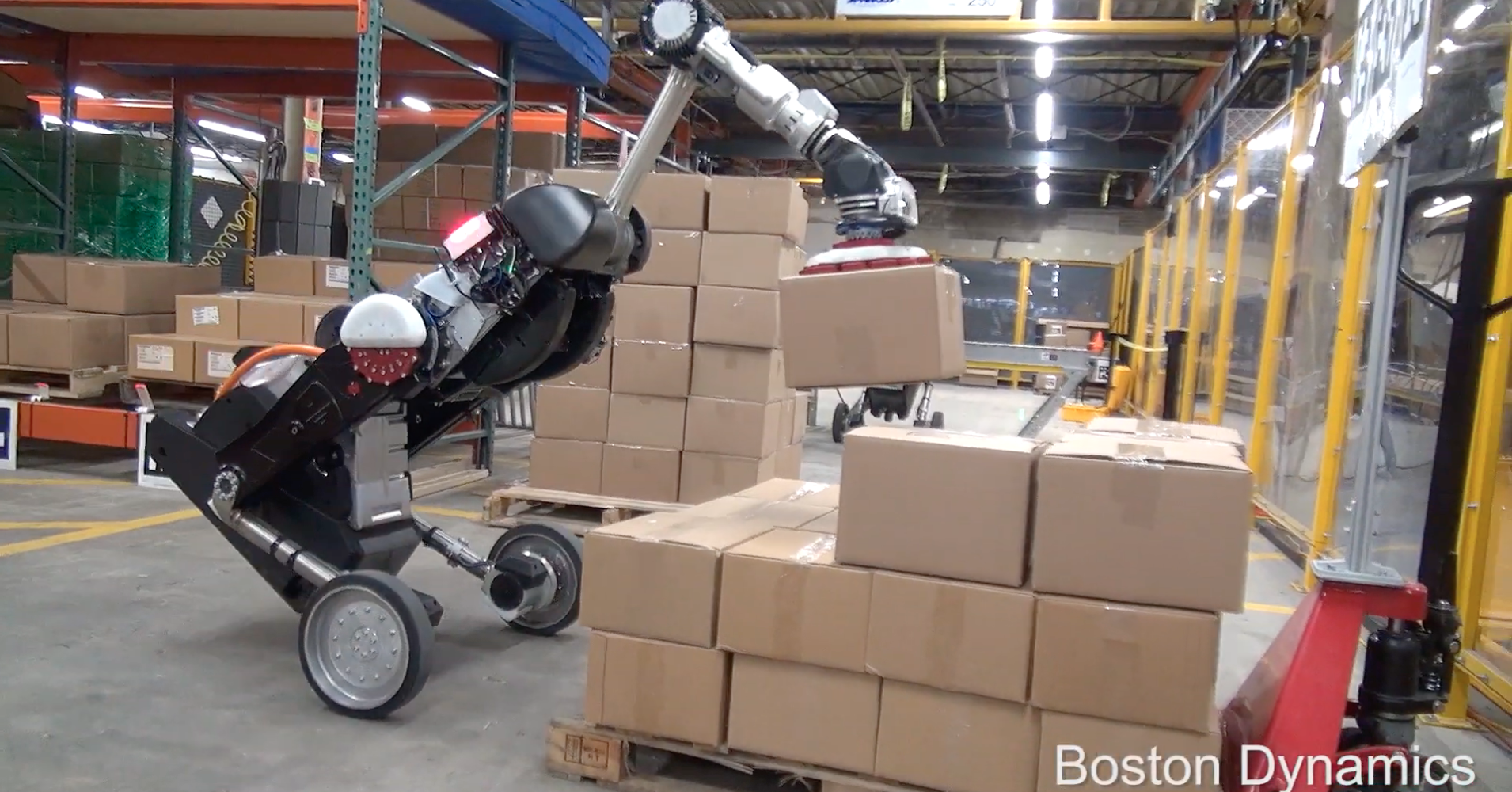 Watch this gigantic bird-like robot load boxes onto a conveyor belt