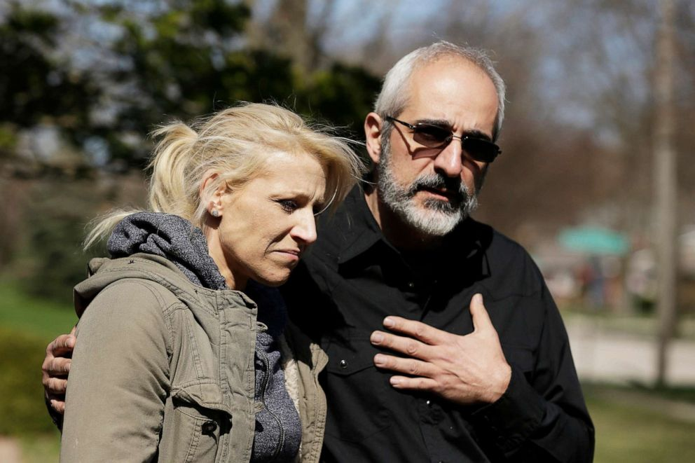 """JoAnn Cunningham, mother of missing 5-year-old child Andrew """"AJ"""" Freund, stands with her attorney George Killis outside the Freund home on Friday, April 19, 2019 in Crystal Lake, Ill."""