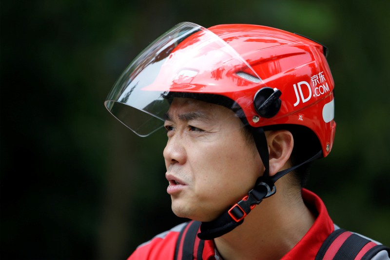 FILE PHOTO: Liu, CEO and founder of China's e-commerce company JD.com, speaks during an interview with Reuters in Beijing