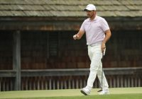 Day lights up Augusta with pain-racked battle for Masters glory