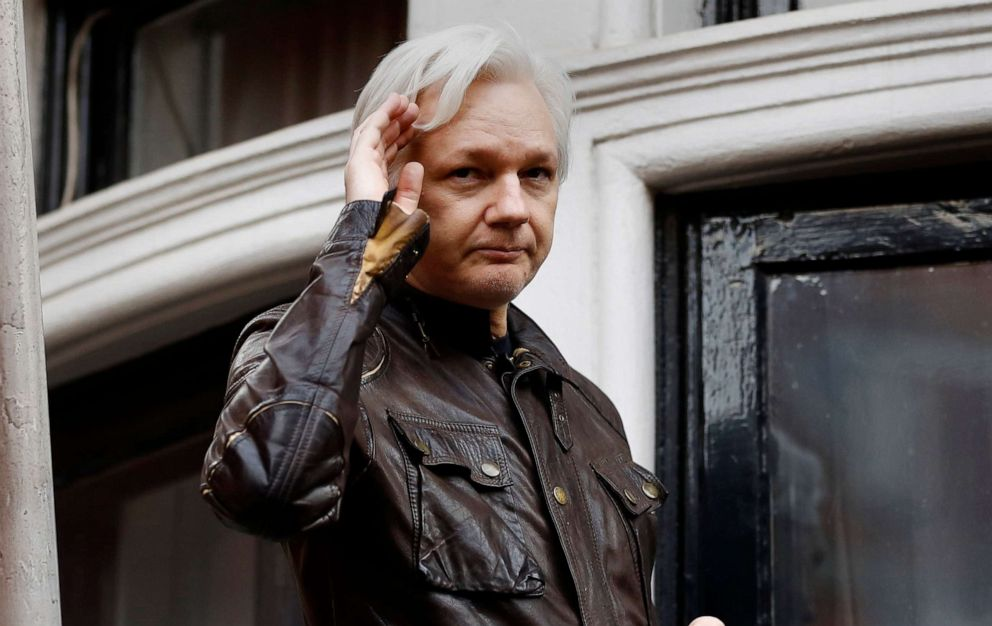 WikiLeaks founder Julian Assange greets supporters from a balcony of the Ecuadorian embassy in London, May 19, 2017.