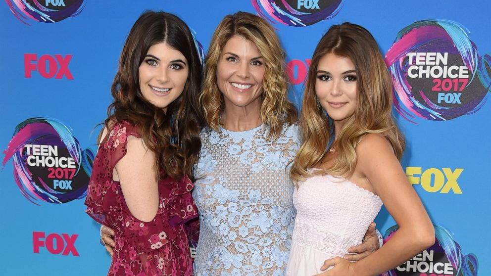 In this Aug. 13, 2017 file photo, actress Lori Loughlin, center, poses with her daughters Bella, left, and Olivia Jade at the Teen Choice Awards in Los Angeles.