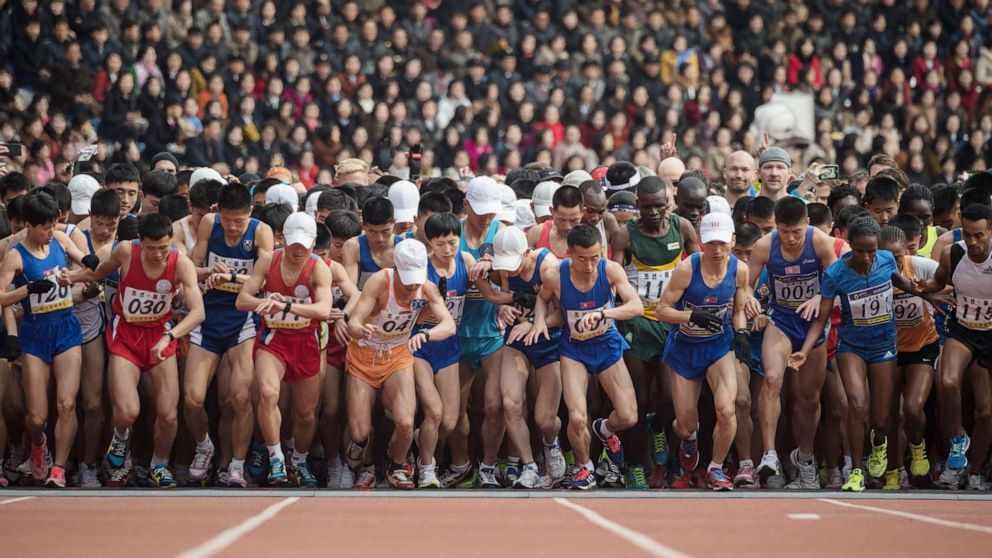 Competitors cross the start line of the the annual Pyongyang marathon at Kim Il Sung stadium in Pyongyang in this April 8, 2018 file photo.