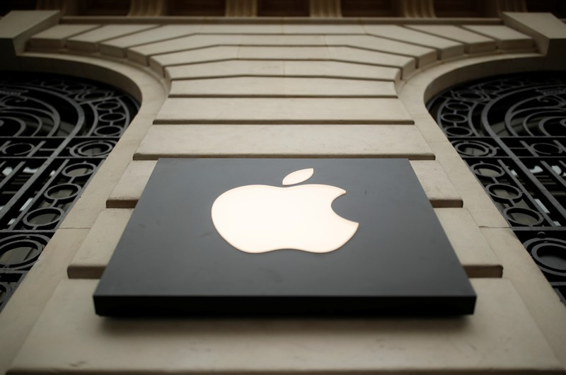 The logo of Apple company is seen outside an Apple store in Paris