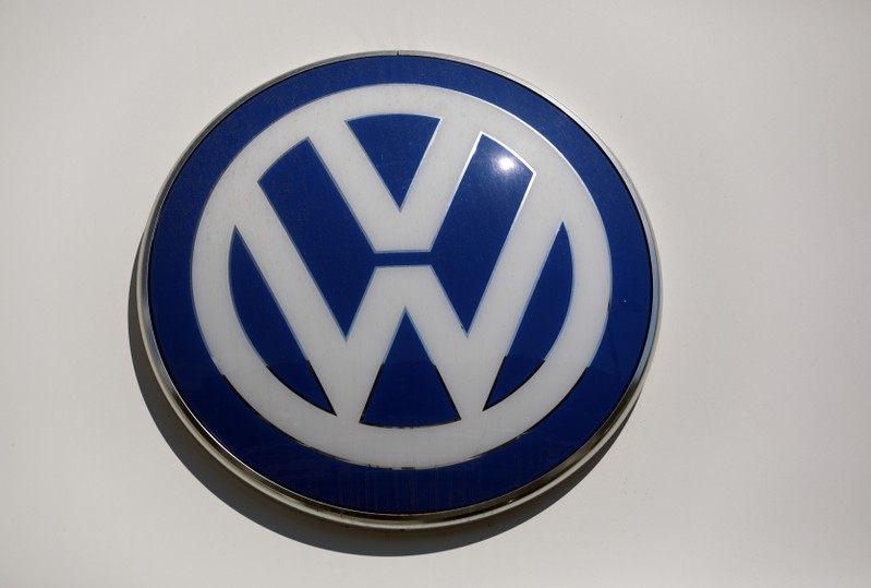 The logo of Volkswagen carmaker is seen at the entrance of a showroom in Nice