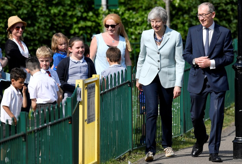 Britain's Prime Minister Theresa May and her husband Philip arrive to vote in the European Parliament Elections, in Sonning