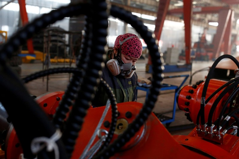 FILE PHOTO: A woman works in the Tianye Tolian Heavy Industry Co. factory in Qinhuangdao