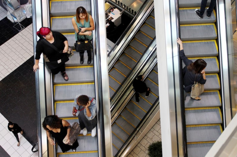 FILE PHOTO - Shoppers ride escalators at the Beverly Center mall in Los Angeles