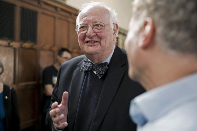 British-born economist Angus Deaton of Princeton University speaks with supporters at a reception after winning the 2015 economics Nobel Prize, at his home in Princeton