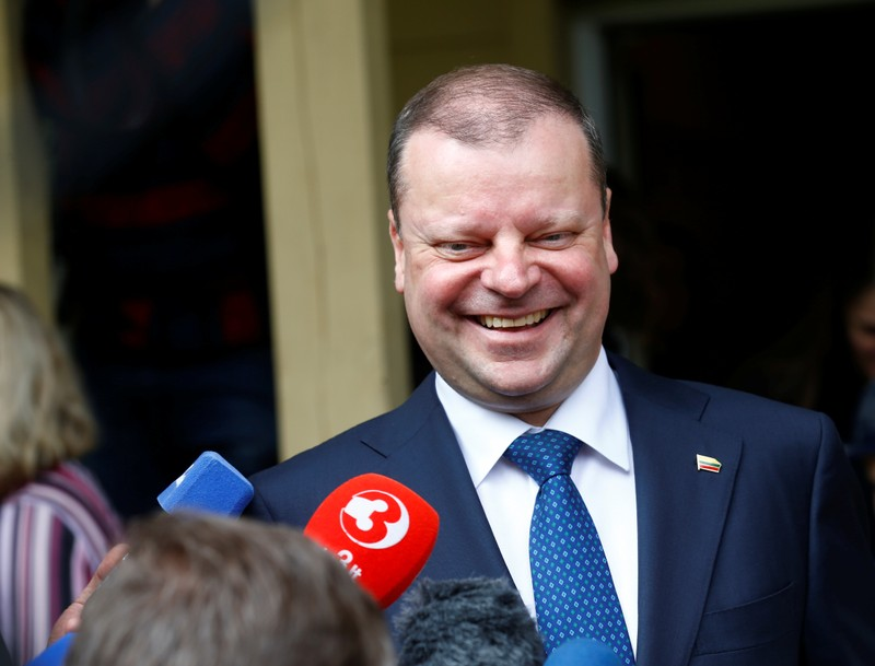 Prime Minister and presidential candidate Skvernelis speaks to media during the first round of Lithuanian presidential election in Vilnius