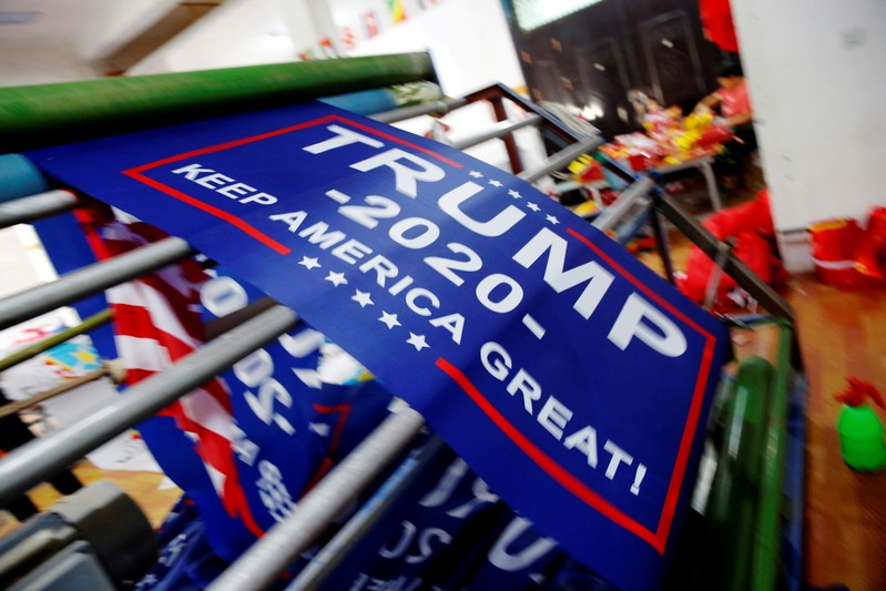 FILE PHOTO: Flags for U.S. President Donald Trump's