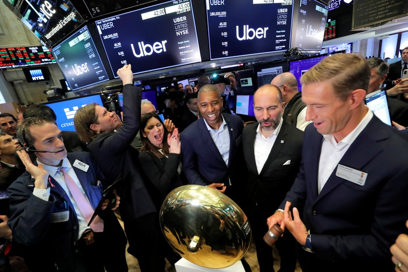 FILE PHOTO: Uber Technologies Inc. CEO Dara Khosrowshahi and co-founder Ryan Graves ring bell on trading floor of NYSE during the company's IPO in New York