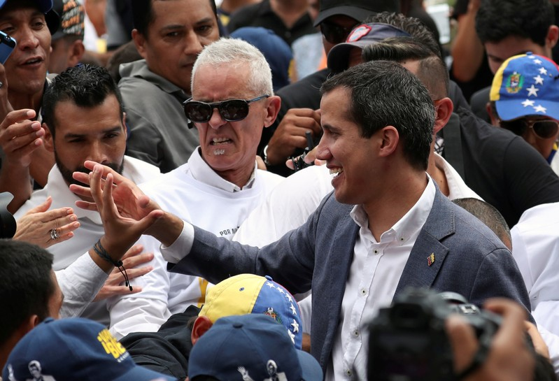 Venezuelan opposition leader Juan Guaido greets supporters as he leaves after a rally in support of the Venezuelan National Assembly and against the government of Venezuela's President Nicolas Maduro in Caracas
