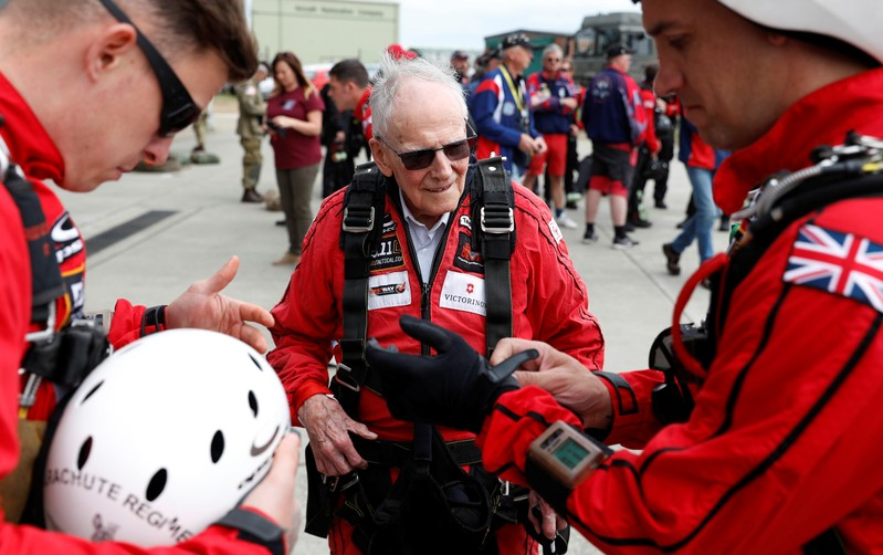 D-Day veteran Harry Read makes his final preparations with members of the Army Parachute Display Team before flying to Normandy in France