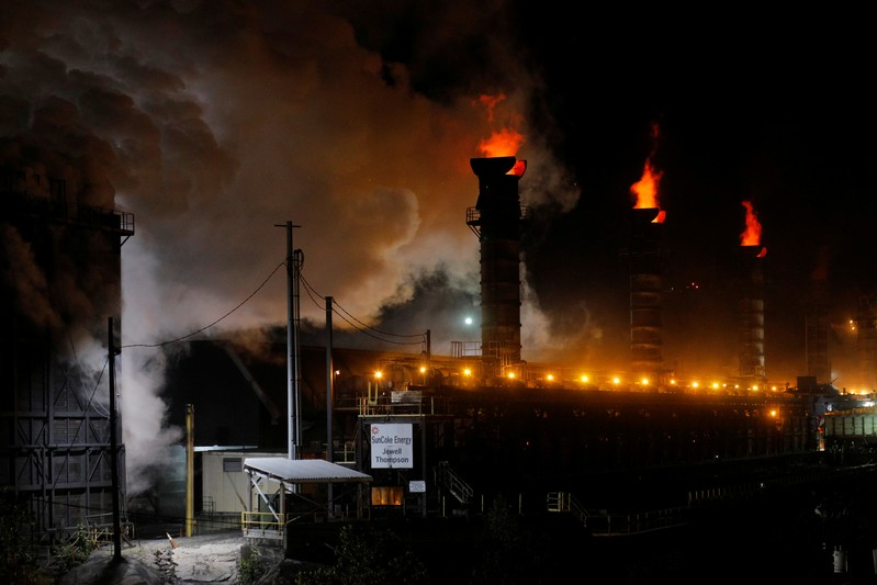 Flames and steam rise from the Suncoke Jewell cokemaking plant, which burns coal to make coke, in Oakwood, Virginia
