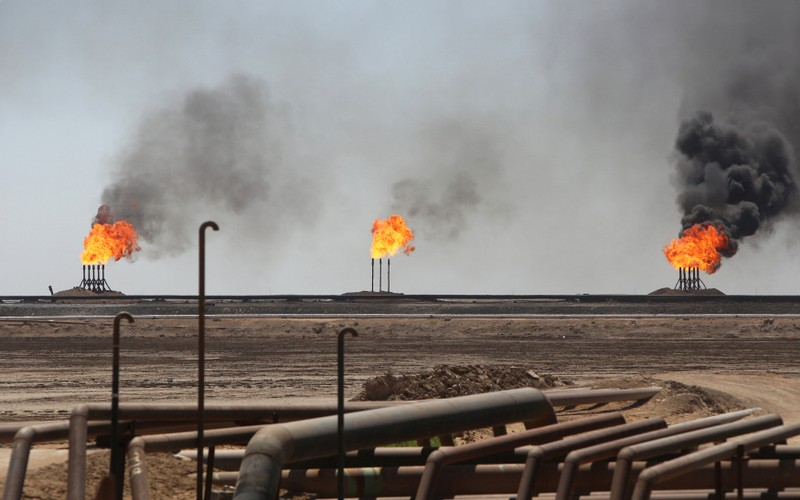 FILE PHOTO: Flames emerge from the flare stacks at the West Qurna-1 oilfield, which is operated by ExxonMobil, near Basra