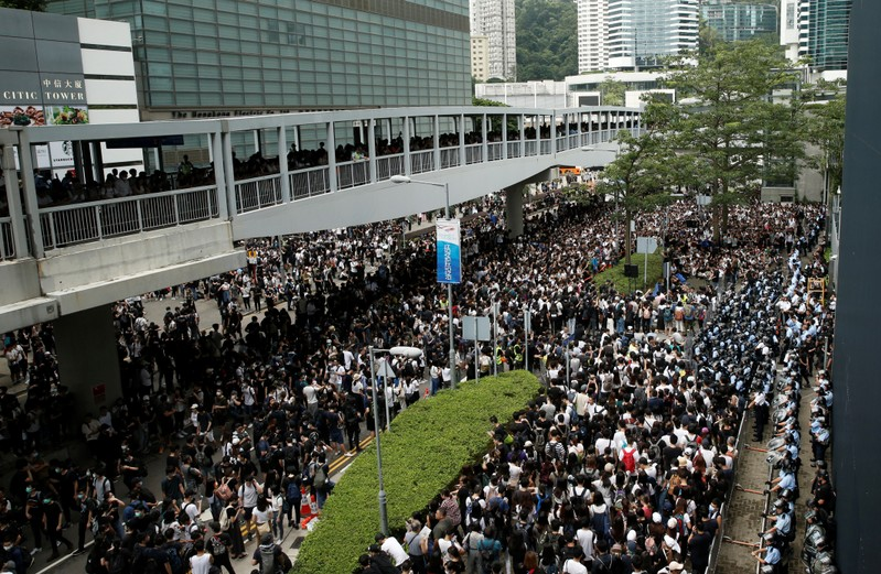 Protesters gather outside the entrance to the Legislative Council building in Hong Kong