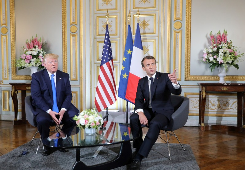 U.S. and French presidents meet on margins of D-Day commemorations