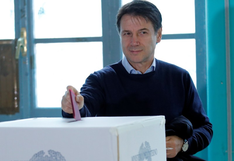 Italian Prime Minister Giuseppe Conte casts his vote at a polling station in Rome