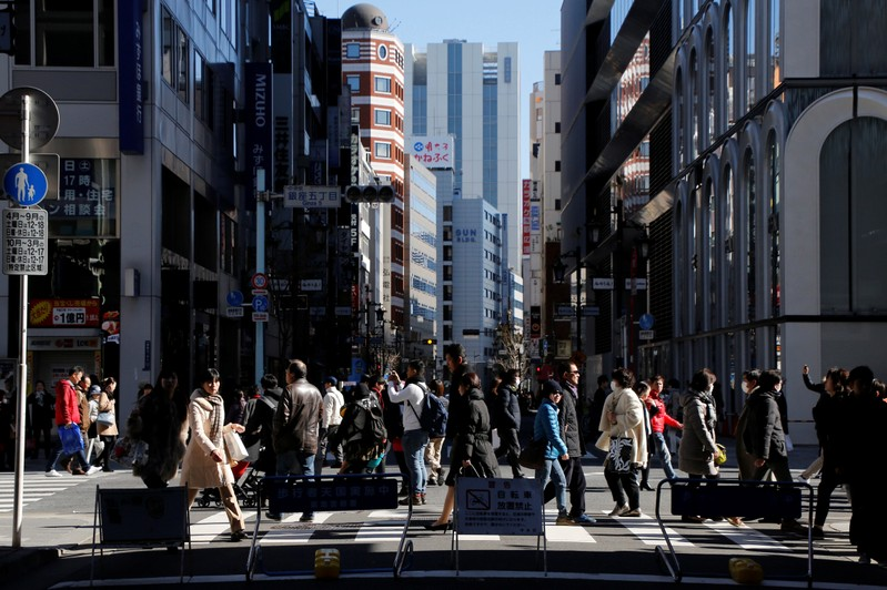 FILE PHOTO: People walk on a street at Tokyo's Ginza shopping district