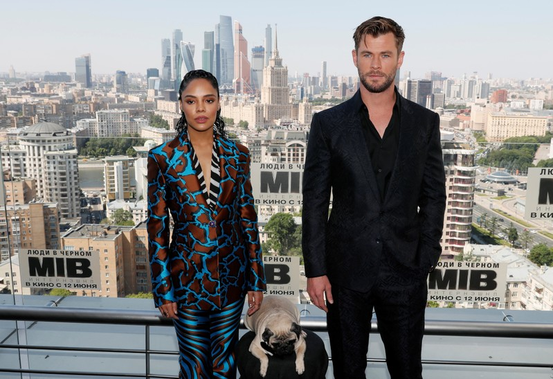Chris Hemsworth and Tessa Thompson pose for a picture during a photocall for the film