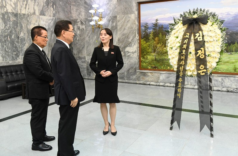 North Korean leader Kim Jong Un's sister Kim Yo Jong talks with South Korean presidential national security director Chung Eui-yong and lawmaker Park Ji-won near the condolence flowers for Lee Hee-ho, the widow of former South Korean President Kim Dae-ju
