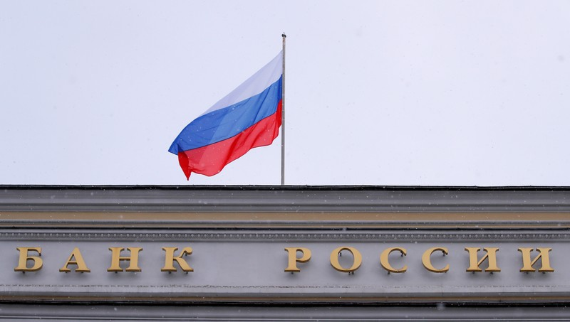 FILE PHOTO: A Russian flag flies over Russian Central Bank headquarters in Moscow