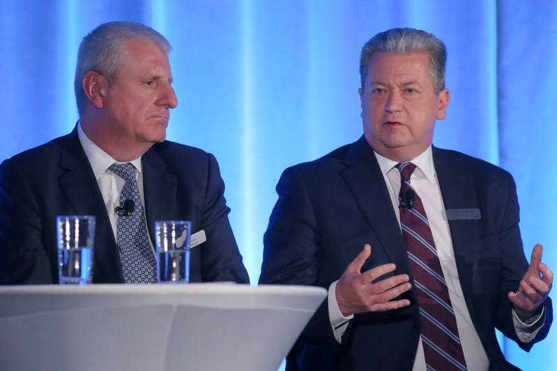 SNC-Lavalin Chief Operating Officer Ian Edwards and SNC-Lavalin President and Chief Executive Officer Neil Bruce speak during the company's annual shareholder's meeting in Montreal