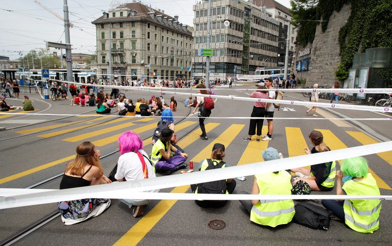 The traffic is blocked by the participants of a women's strike at the Central Square in Zurich