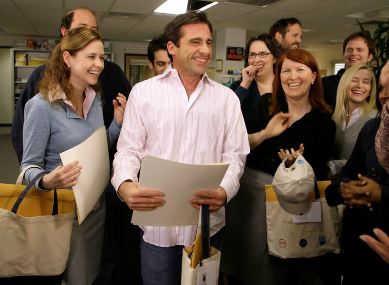 FILE PHOTO: Actor Steve Carell laughs along with other members of