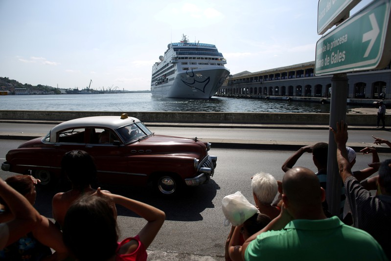 FILE PHOTO: People look at the arrival of U.S. Carnival cruise ship Adonia at the Havana bay, the first cruise liner to sail between the United States and Cuba since Cuba's 1959 revolution