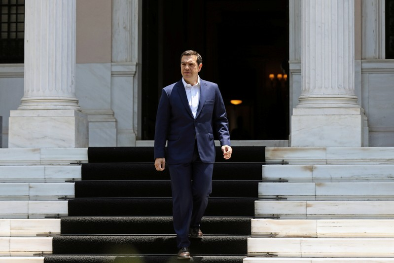 Greek Prime Minister Alexis Tsipras exits the Maximos Mansion to make a media statement in Athens