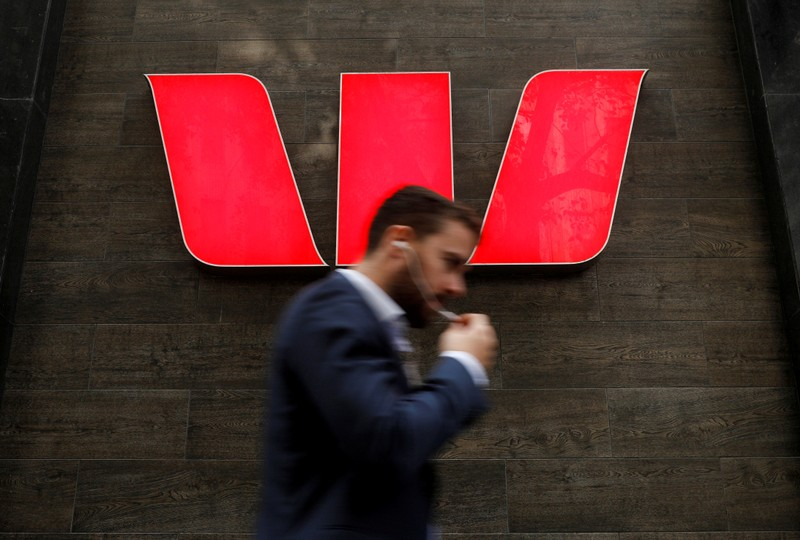 FILE PHOTO: A man walks past a Westpac bank branch in Sydney, Australia