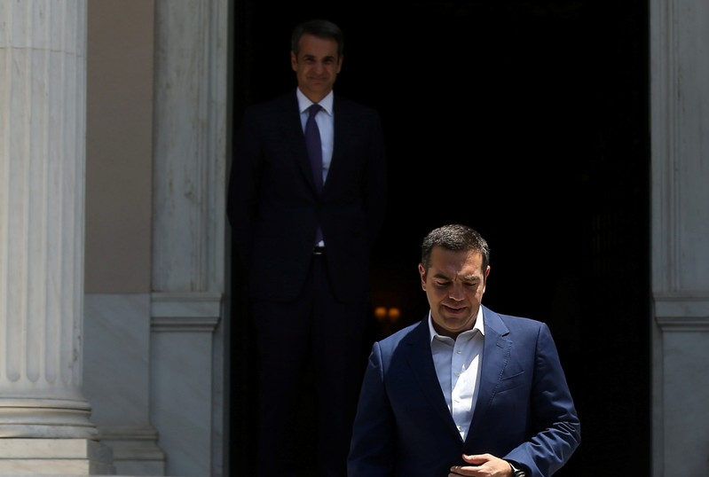 Newly-appointed Greek Prime Minister Mitsotakis meets with outgoing Prime Minister Tsipras in Athens