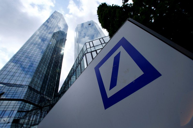 FILE PHOTO: A Deutsche Bank logo adorns a wall at the company's headquarters in Frankfurt