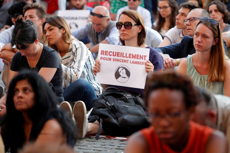 FILE PHOTO: People demonstrate in support of French quadriplegic Vincent Lambert in Paris