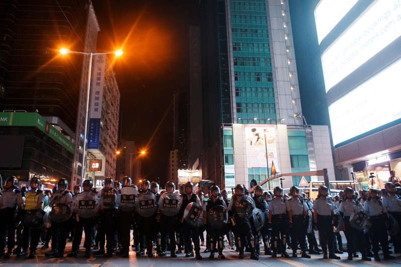 Riot police take position to disperse anti-extradition bill protesters after a march at Hong Kong's tourism district Nathan Road near Mongkok